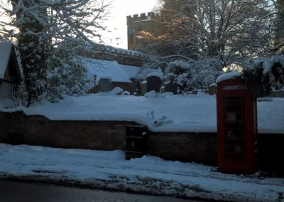 A wintry looking Church and Telephone Box